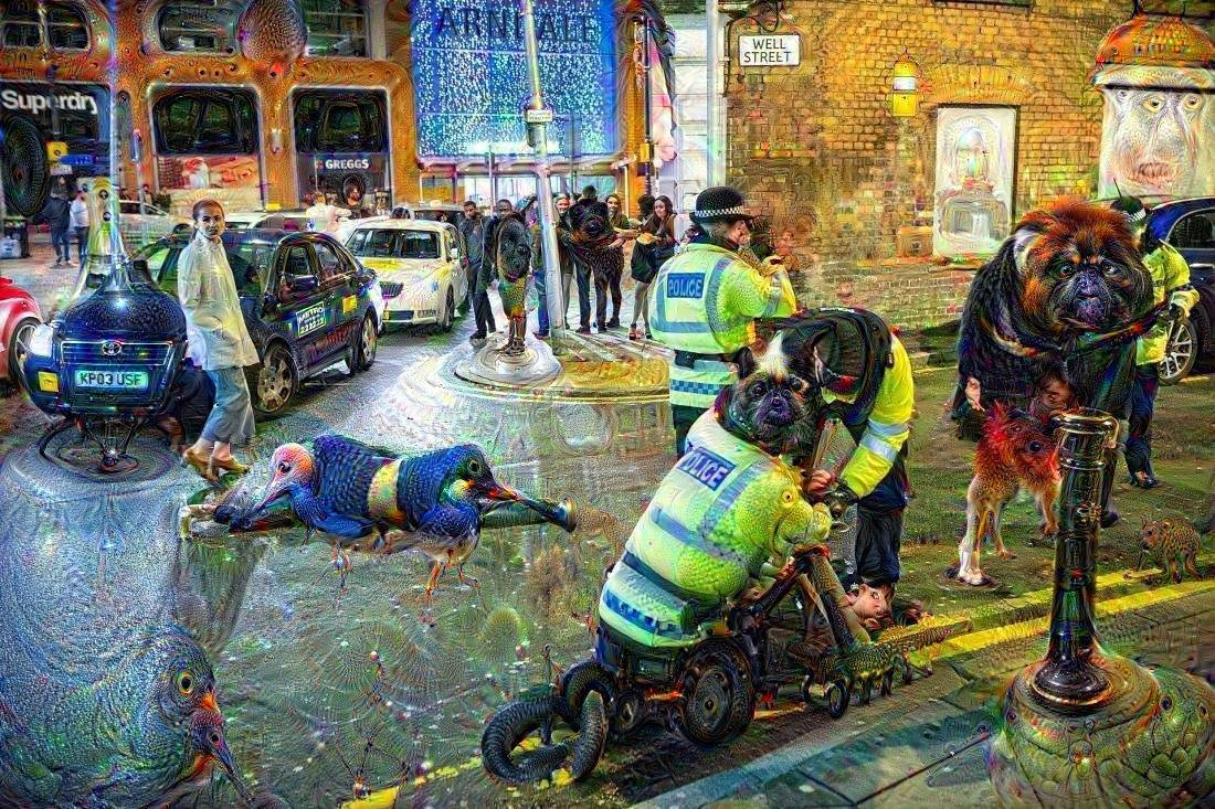 A famous photograph of New Year's Eve in Manchester which has been fed through a machine learning thing that recognises faces and creatures in things, creating a wonderfully disturbing and psychedelic image