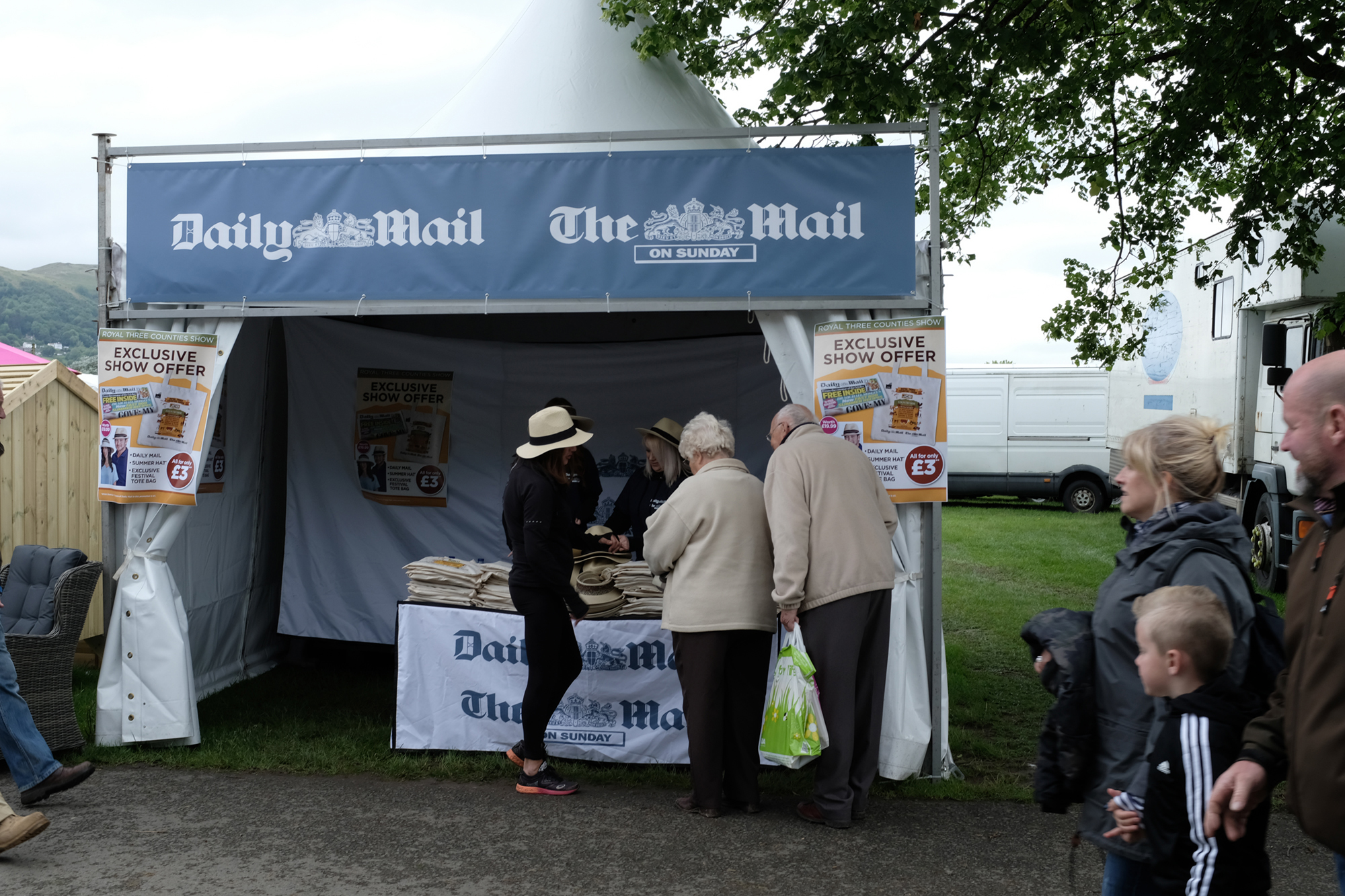 Photo of a beige-clad older couple showing interest in the Daily Mail tent